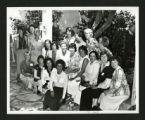 Scripps alumnae sitting together by a class of '59 sign in Margaret Fowler Garden, Scripps College
